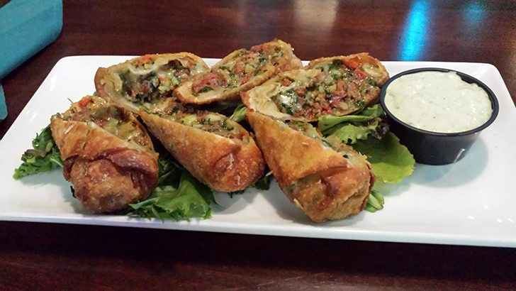Sicilian rolls at City Line are stuffed with pepperoni, prosciutto, roasted red peppers, spinach and mozzarella, and served with a creamy pesto dip. (Caroline Lee)