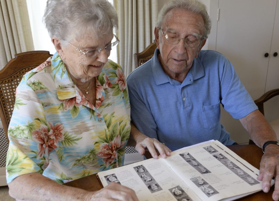 Betty and Anthony Marotta look through the 1947 Accropolis Year Book in their Scotia home on June 24.