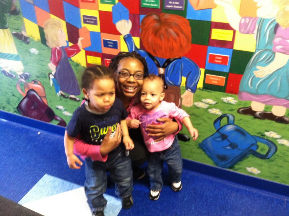 Nyasia Darby stands in front of a mural at the Schenectady Day Nursery with her children: Khamari, 2, and Khamaia, 18 months. Darby said she can't leave work to drive Khamari from a half-day pre-K program to daycare.