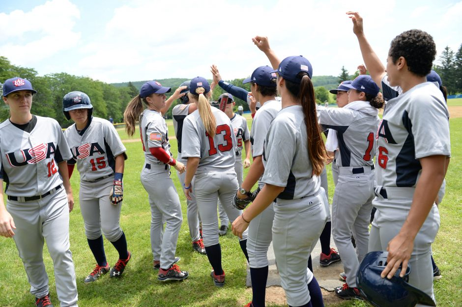 The USA Baseball women's national team gets together prior to playing the Women's Baseball Federation of Japan's Madonna Stars in the opening game of the Cooperstown Women's Baseball Classic at SUNY-Cobleskill Friday.