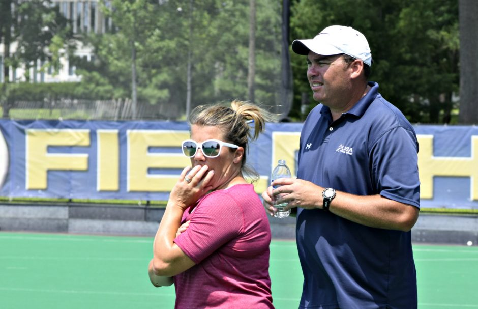 Jen Sykes, director of ADK Field Hockey, and her husband Phil, the head coach at the University at Albany, watch action during a Wicked Smart Northeast Field Hockey League game Sunday at UAlbany.