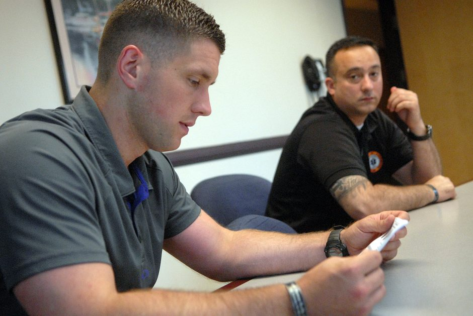 Matt Seeber reviews the lesson plans for an EMS training program beside Joe Santiago, executive director of the Clifton Park and Halfmoon Emergency Corps, on Sunday, July 19, 2015.