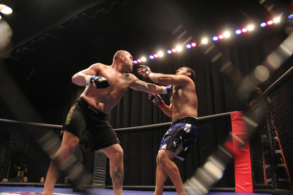 Schenectady heavyweight Guy Hammond throws a punch at opponent Jordon Moyer during a Cage Wars Mixed Martial Arts bout earlier this year.