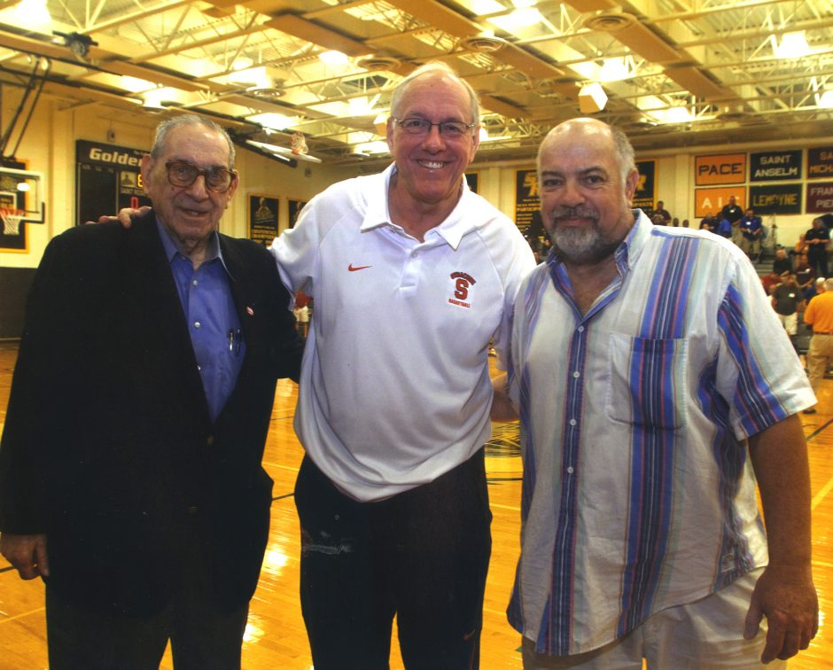 From left, Howard Garfinkel, Syracuse coach Jim Boeheim and Rene LeRoux, the executive director of the New York State Basketball Hall of Fame, are shown at a 2014 basketball clinic in Albany.
