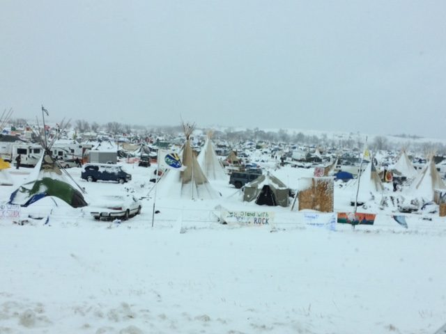Tents and other temporary structures are seen under a blanket of snow Monday at the Standing Rock reservation in North Dakota.