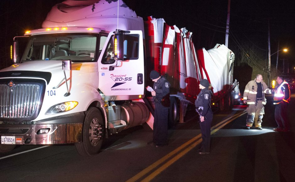 Glenville Police officers question a trucker from Quebec City failed to negotiate the height limitation of a railroad bridge on Maple Avenue and ripped the entire top of the trailer completely off on Monday. No injuries were reported. Officials from CR...