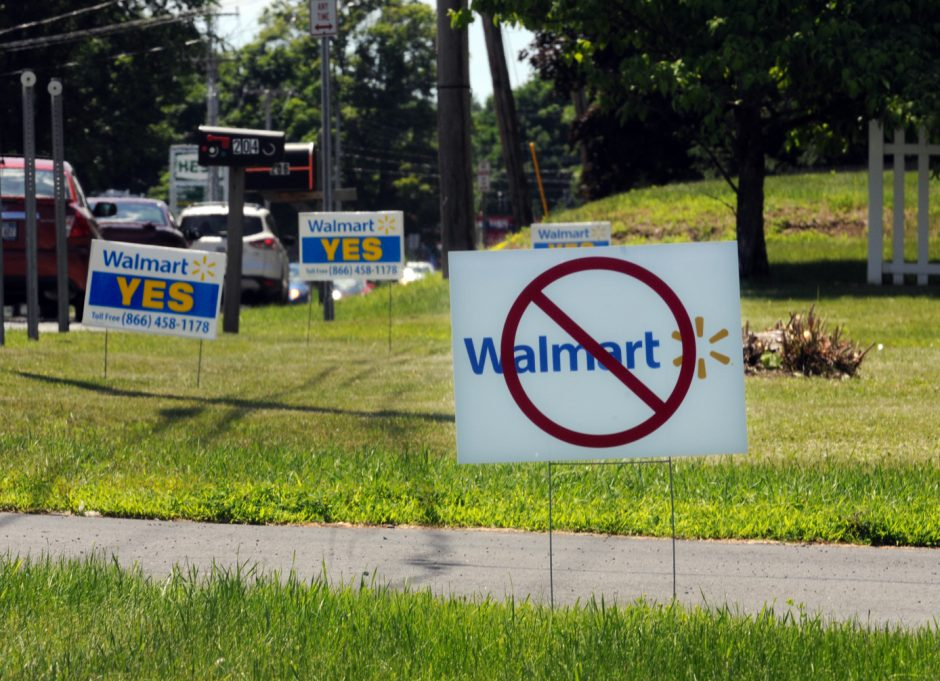 Signs pro- and anti-Wal-Mart on the front lawns of homes along Route 50 in Ballston Spa on June 20, 2014.