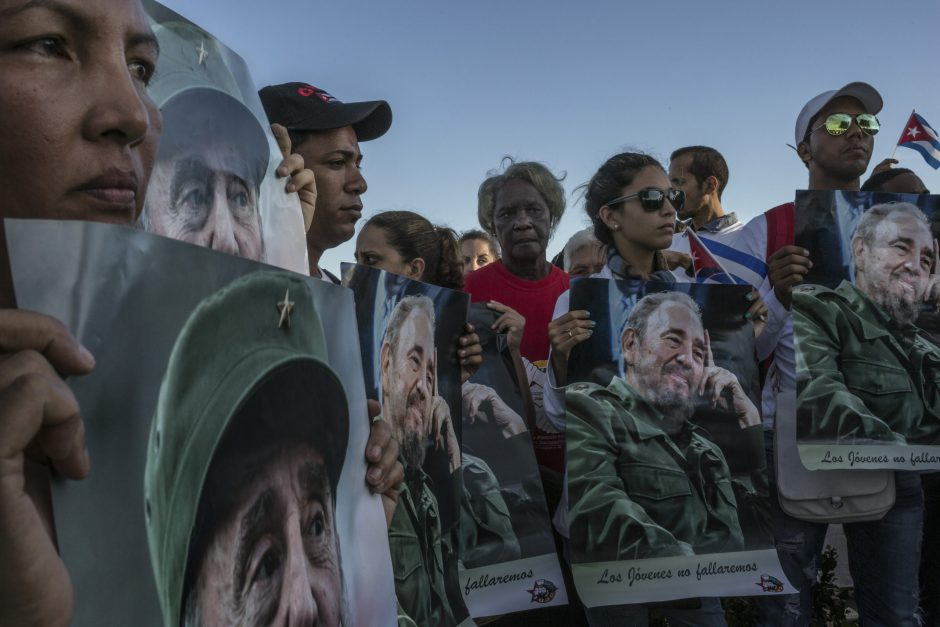 People gather near the cemetery where Fidel Castro was buried in Santiago de Cuba on Sunday. Bringing to an end nine days of national mourning, the ashes of Fidel Castro were buried on Sunday morning in a cemetery in this coastal city where, 63 years a...