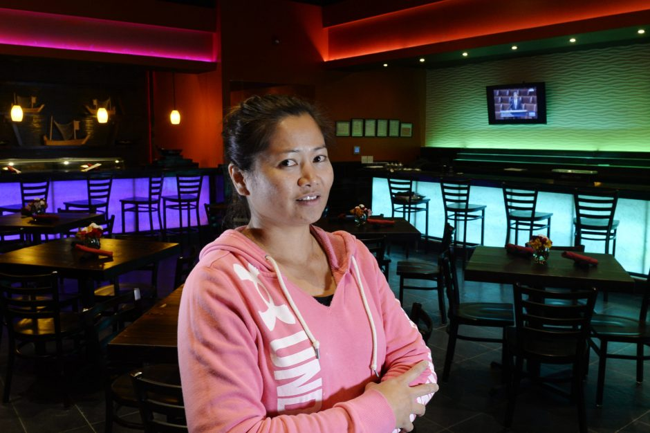 Owner of the Thai Thai Bistro Piyamas DeMasi stands in the dining room in her new location