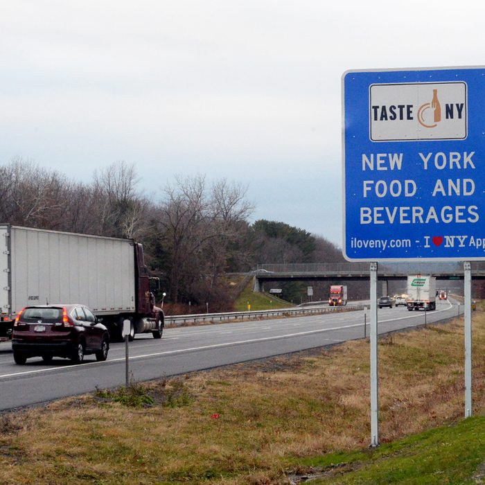 A New York State tourism sign is visible along the Thruway westbound between exits 25 and 25A.