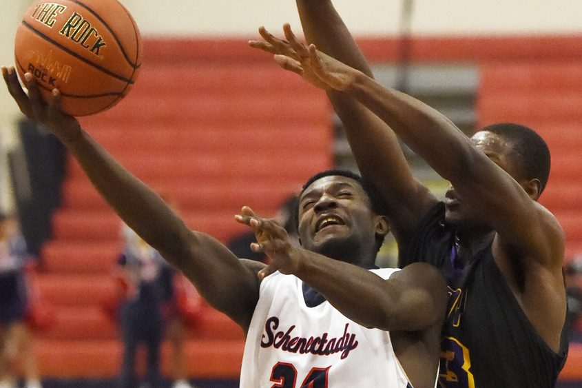 John Ryals of Schenectady takes a shot while being guarded by Elijah Davis of Troy.