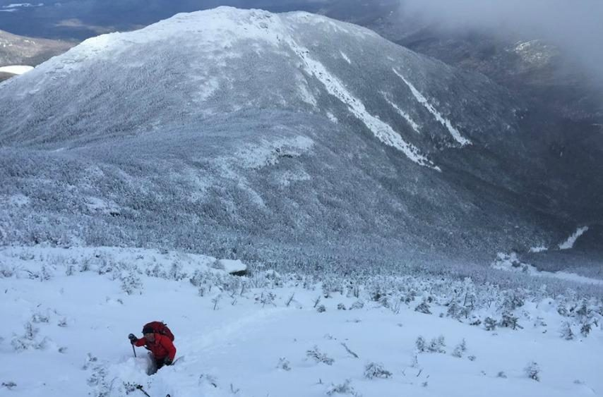 A Forest Ranger hikes through three-foot-deep snow on Algonquin Peak during the search