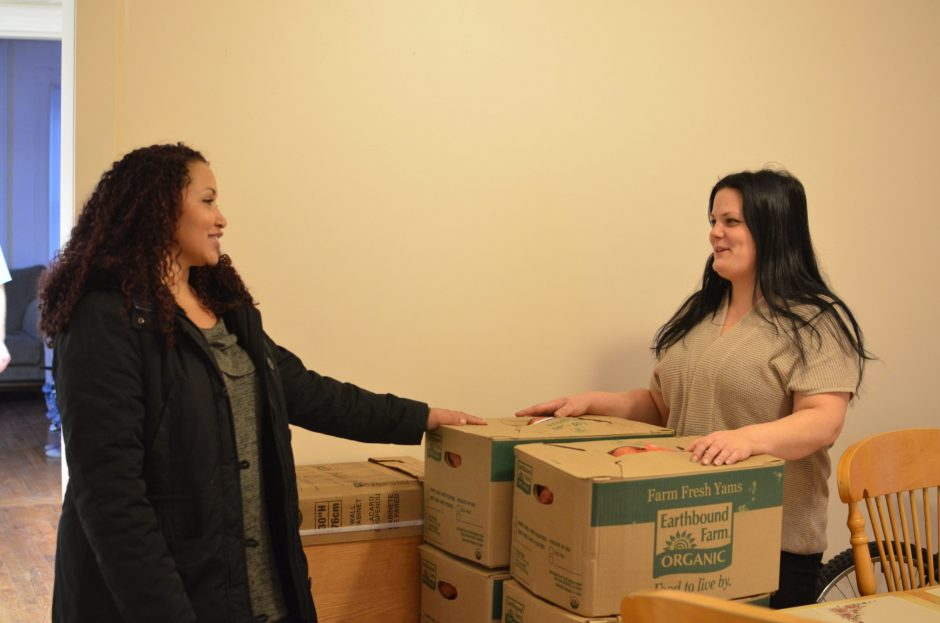 Ashley Fraser, left, and Jennifer Salamo check on produce delivered to Danielle's House.