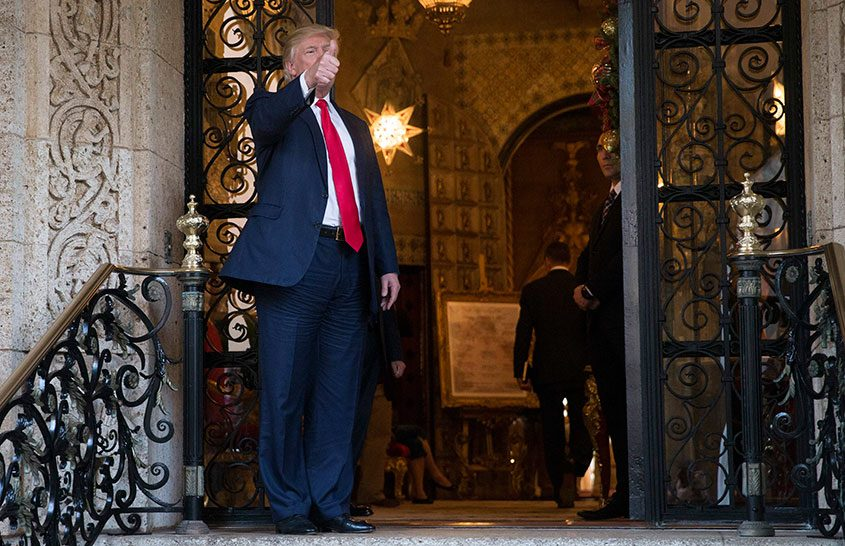 Donald Trump on the front steps of his Mar-a-Lago resort after meeting with officials from the Pentagon, Dec. 21, 2016.
