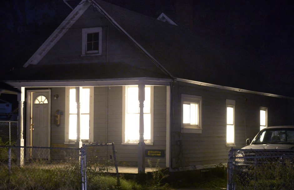 "A vacant home in Schenectady is illuminated during ""Breathing Lights."""