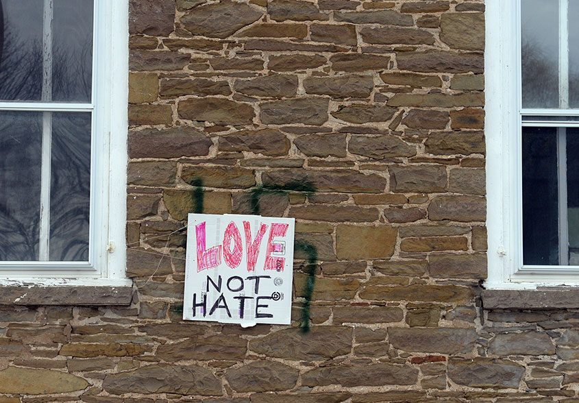 """Swastika graffiti covered by """"Love not Hate"""" at the Esperance Presbyterian Church in the village of Esperance on Jan. 2, 2017"""