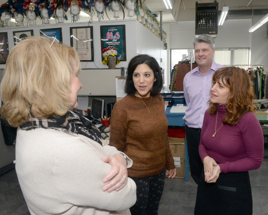 "Kathe Sheehan, left, and Costumer owner Erik Johnsen converse with costume designers from the show ""Something Rotten."""