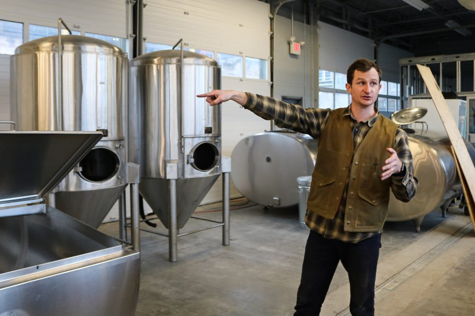 Harry Whalen, owner and founder of the future Great Flats Brewery in Schenectady, explains the newly-installed machinery.