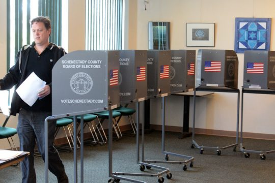 At the Jewish Community Center, Jeff Witsoe finishes voting in the NYS Primary on Tuesday April 19, 2016.