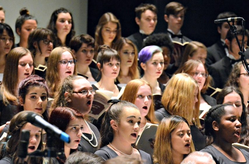 The Schenectady Symphony Orchestra and Niskayuna High School's combined mixed chorus and children's chorus.