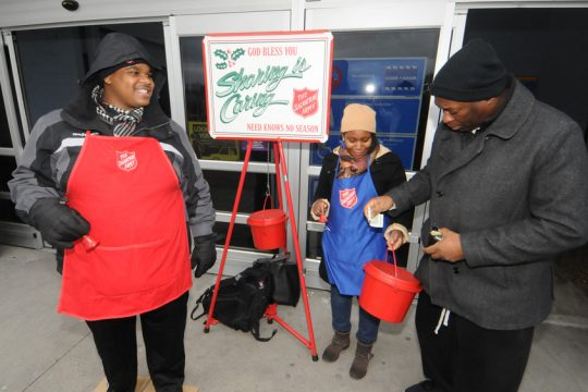 Chris Brown and Sandya Sainvil ring bells for the Salvation Army kettle drive in December 2014.