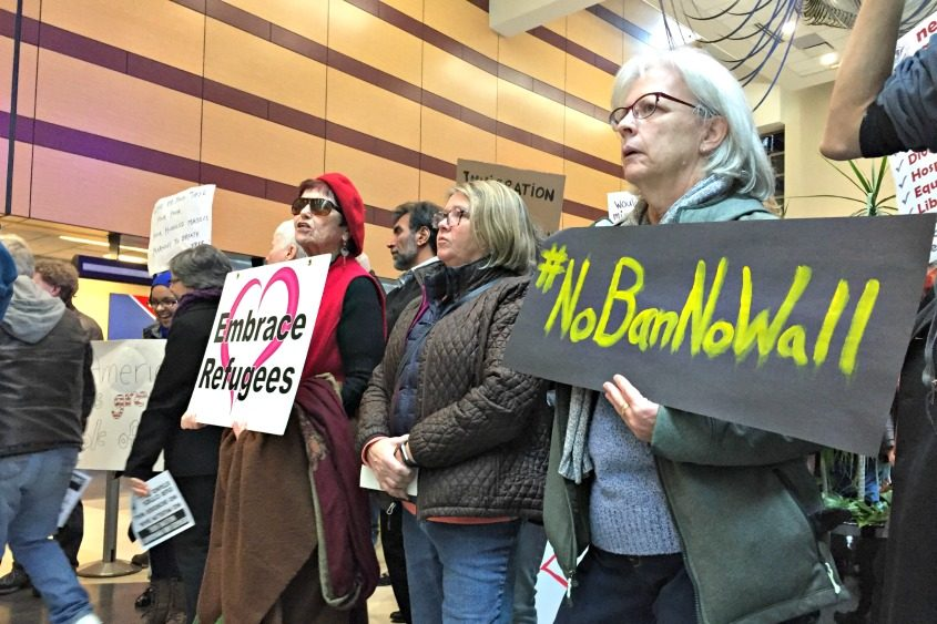 Jenny Philbrook (right), of Latham, and hundreds of others gather Sunday at Albany International Airport.