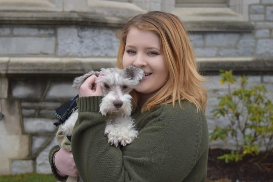 Rosemarie Davidson with Treena, her psychiatric service dog, on the campus of Emma Willard School.