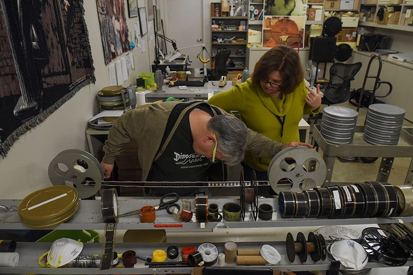 George Willeman and Lynnanne Schweighofer look through one of the reels of a WWI film at the Library of Congress.