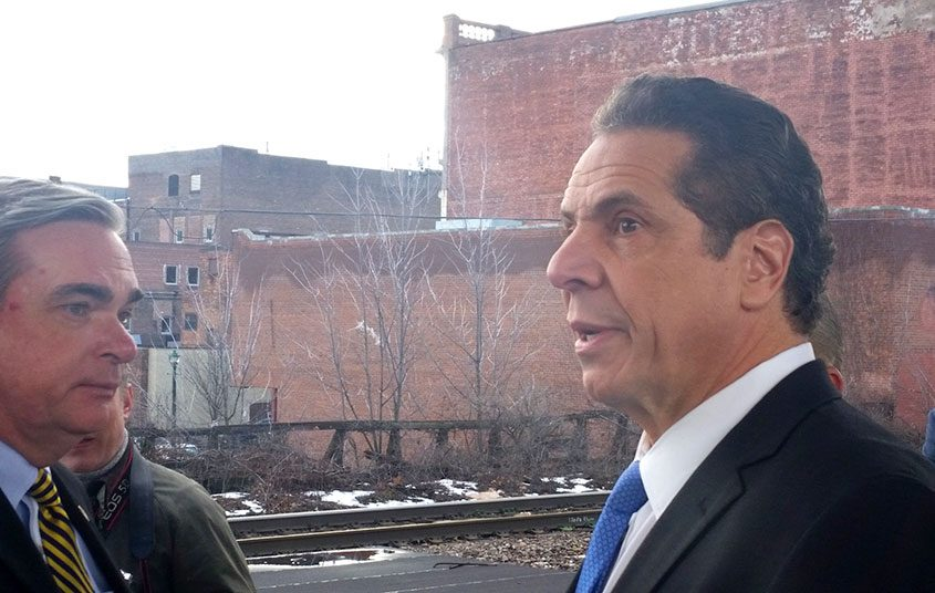 Gov. Andrew Cuomo listens along with Schenectady Mayor Gary McCarthy during a tour of the city train station on Feb. 8, 2017.