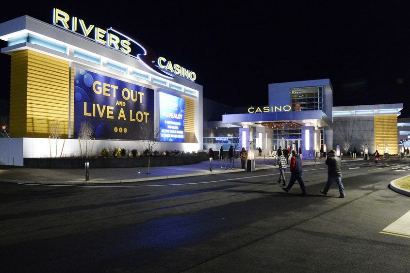 Visitors walk toward Rivers Casino on opening night, Wednesday, Feb. 8, 2017.