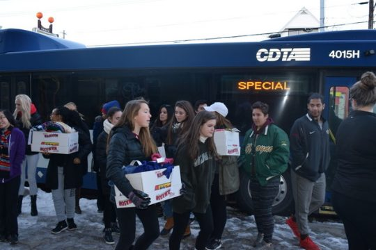 Students from Niskayuna and Schenectady distributed around 500 scarves, gloves, hats and ear warmers along State Street.