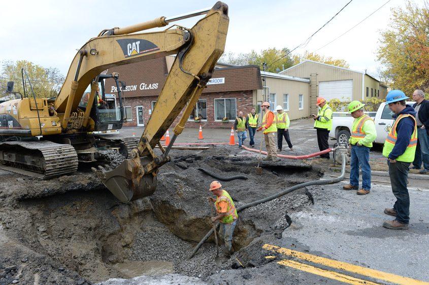 Crews work to contain a water main break on Freemans Bridge Road in Glenville in October 2014.