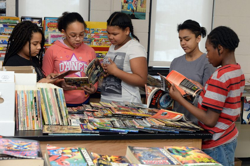 Oneida Middle School students in the comic book library.