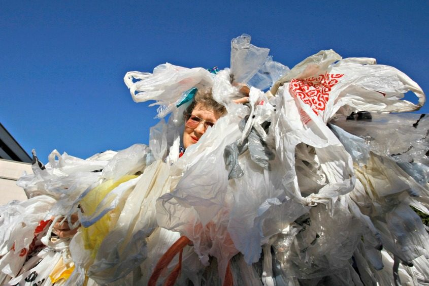 Laurie Gould of Pasadena, California, is covered with hundreds of plastic bags during a rally.
