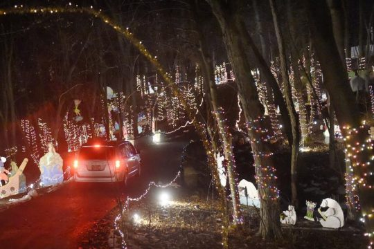 Cars meander through the Amsterdam Lights Show in 2014.