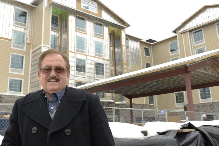 Pat Popolizio, owner of Waters Edge Restaurant, stands in front of the new Hilton Hotel on his property.