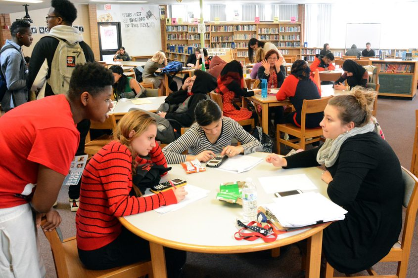 Students work together in the Schenectady High School library during an after-school program Tuesday.