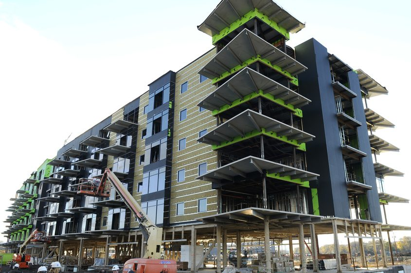 The Riverhouse Apartments wrap around the side of Mohawk Harbor in Schenectady, as seen in October 2016.