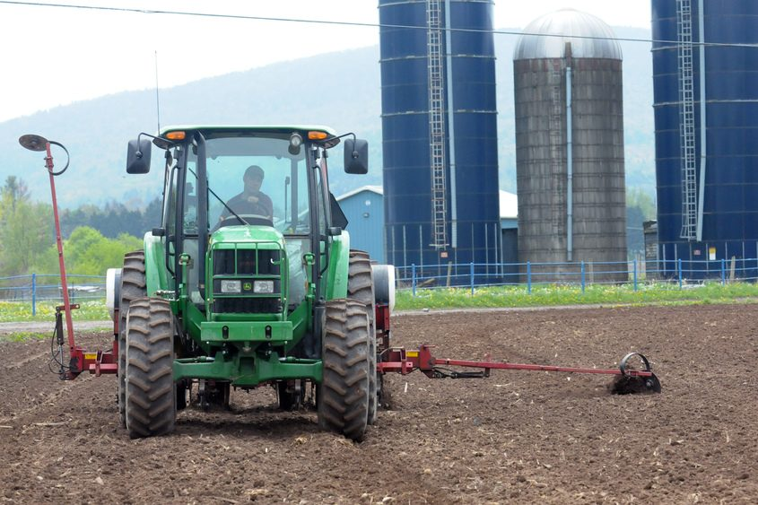 Jason Lloyd of Maple Downs Farms in Middleburgh sows in corn seed.