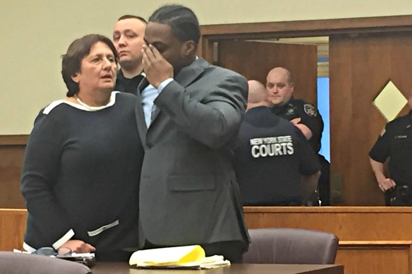 Tyshawn Plowden and his attorney Cheryl Coleman react to a complete acquittal Wednesday, March 29, 2017.