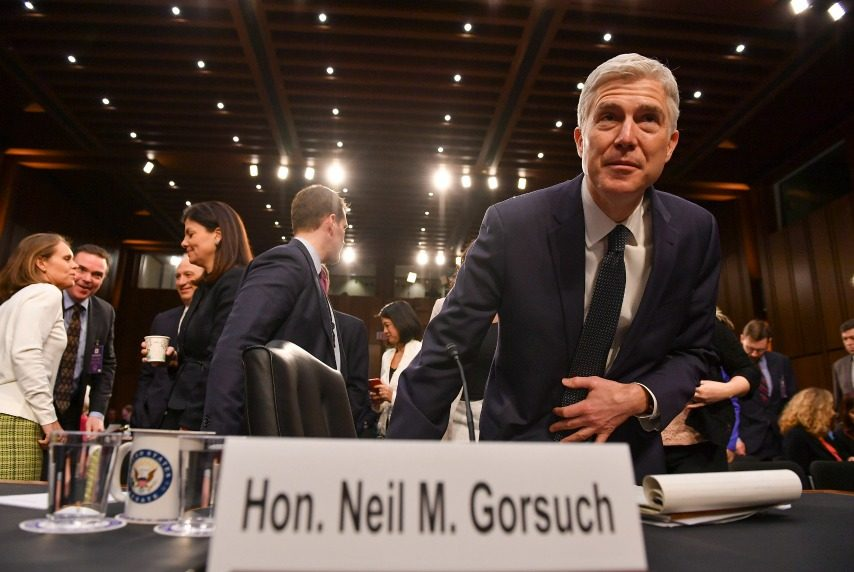 Neil Gorsuch returns after a recess during the third day of his confirmation hearing.