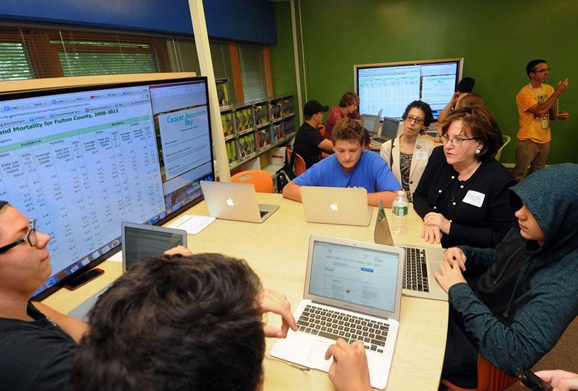 State Education Commissioner MaryEllen Elia tours a school in 2015.