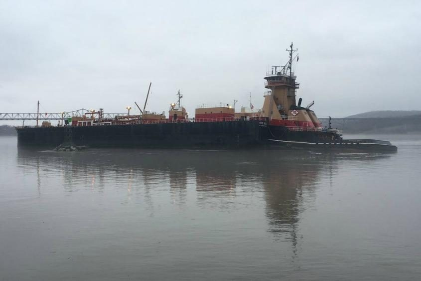 A barge carrying 2.5 million gallons of gasoline ran aground just south of the Rip Van Winkle Bridge over the Hudson River.