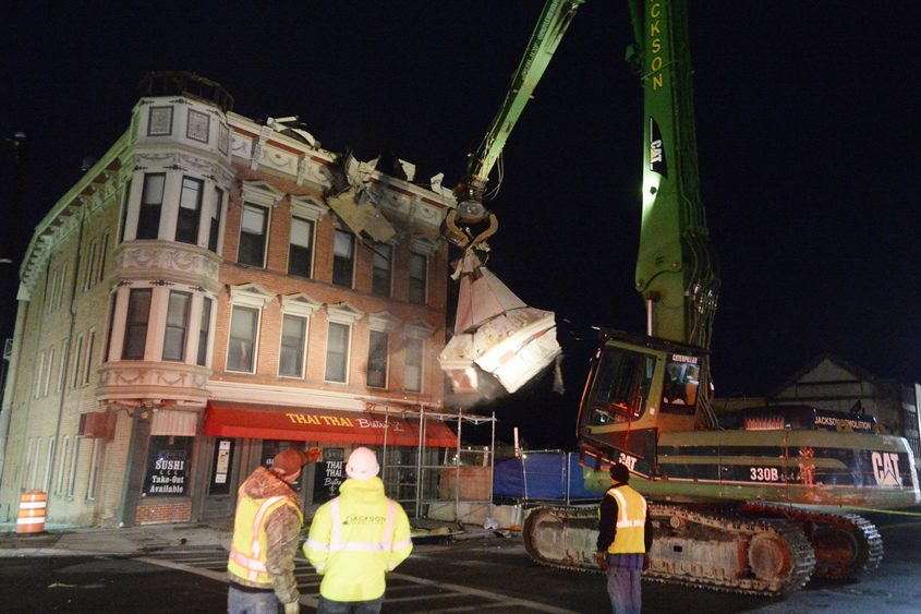 The Nicholaus Building in Schenectady was torn down by a Jackson Demolition excavator on Friday evening.