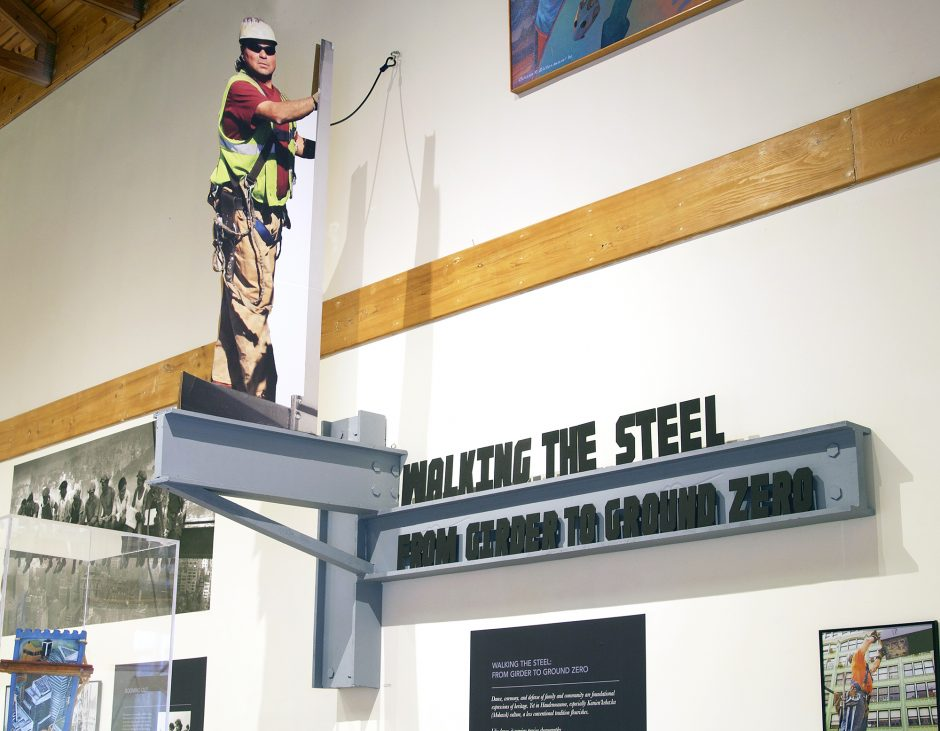 A photo of Turhan Clause, an Algonquin and Mohawk ironworker, on a fake beam in the exhibit.