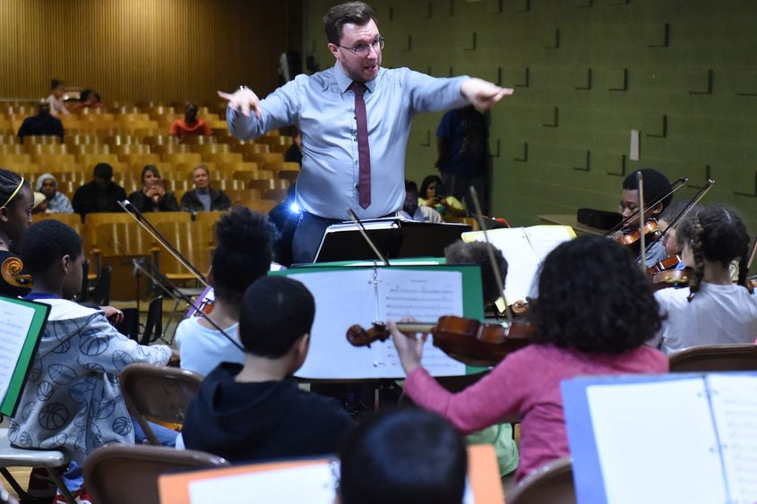 John Connelly conducts the CHIME orchestra at Yates Elementary School in Schenectady.