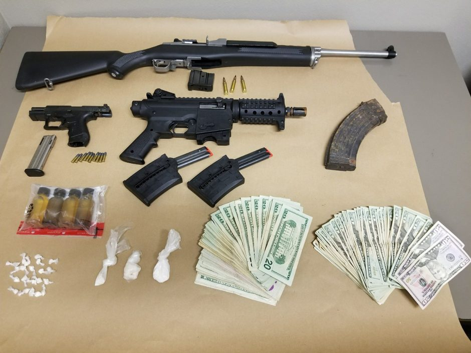 These are the weapons and magazines seized during a search of a Germania Avenue home Thursday night.