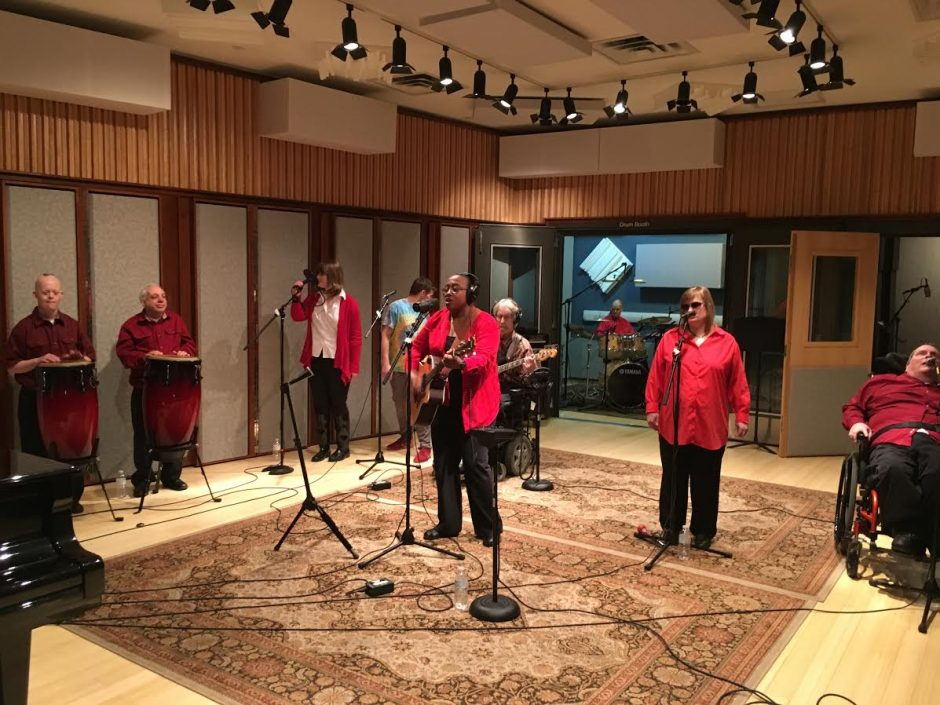 Members of the music group Flame, of Fulton County, are shown recording a Christmas album Friday at SCCC.