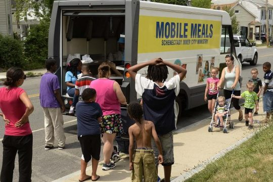 Schenectady Inner City Ministry workers hand out free meals on Eastern Avenue on July 7, 2016.