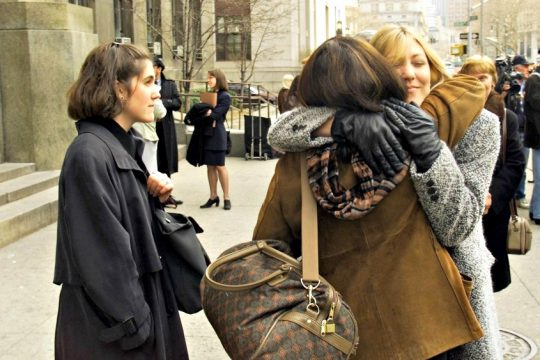 Kim Webdale (right) and Krista Webdale, the sisters of Kendra Webdale, take turns hugging a juror in March 2000.